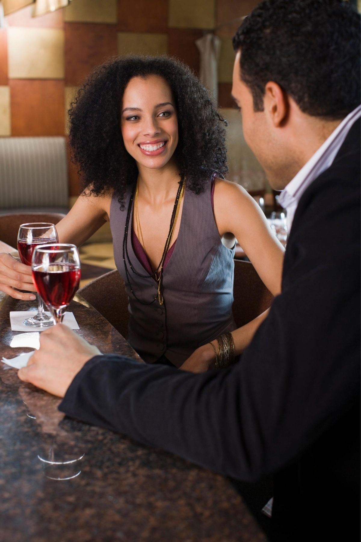 two people having a drink in a bar